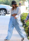 Hailey Bieber flashes her toned abs in a cropped blazer and baggy jeans while out with Justin Bieber in Brooklyn, New York City