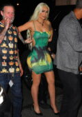 Iggy Azalea shows off her curves in a body-hugging mini dress while arriving at an after-party at Scarlett in New Jersey