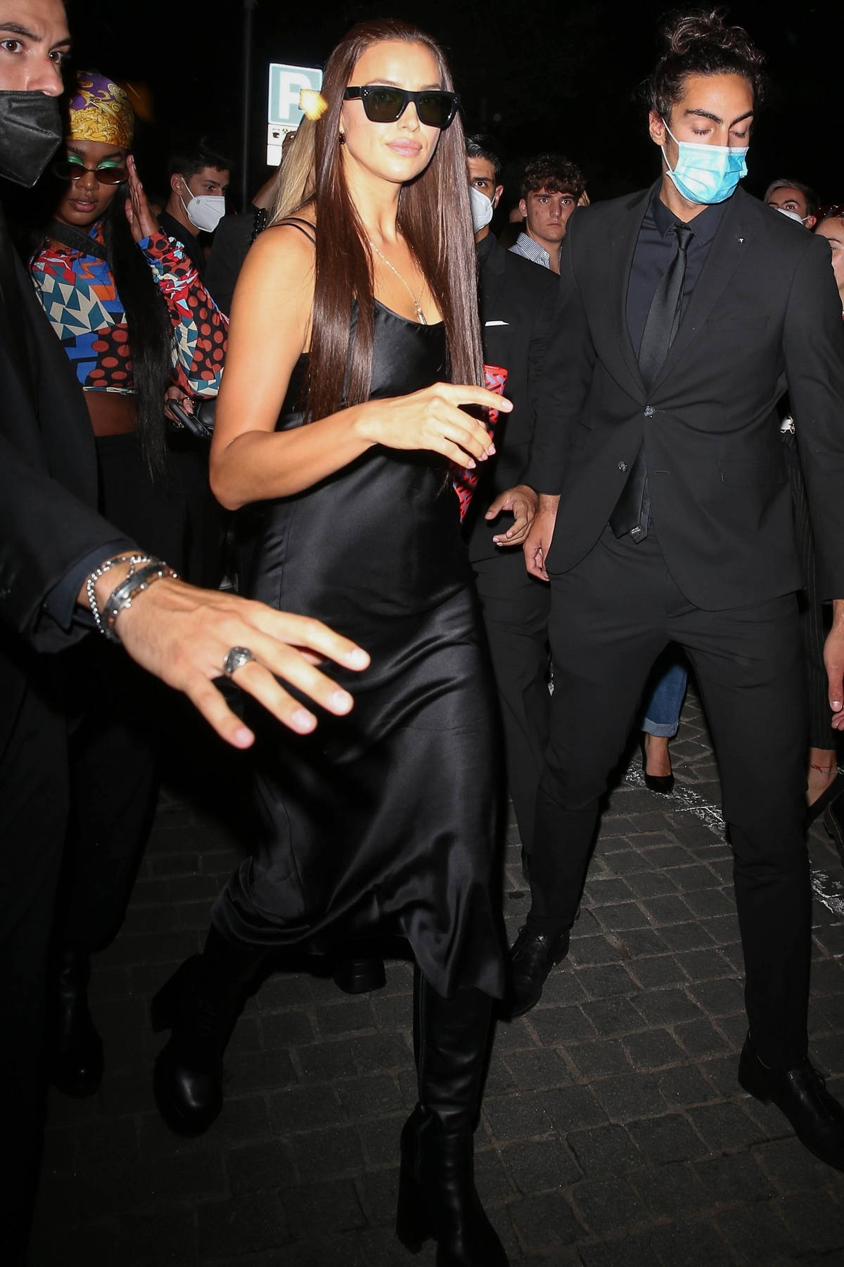 Irina Shayk greets fans as she leaves the Versace SS22 Show with Stella Maxwell during Milan Fashion Week in Milan, Italy