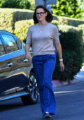 Jennifer Garner looks great in sweater and flared denim while out for a walk with a friend in Brentwood, California