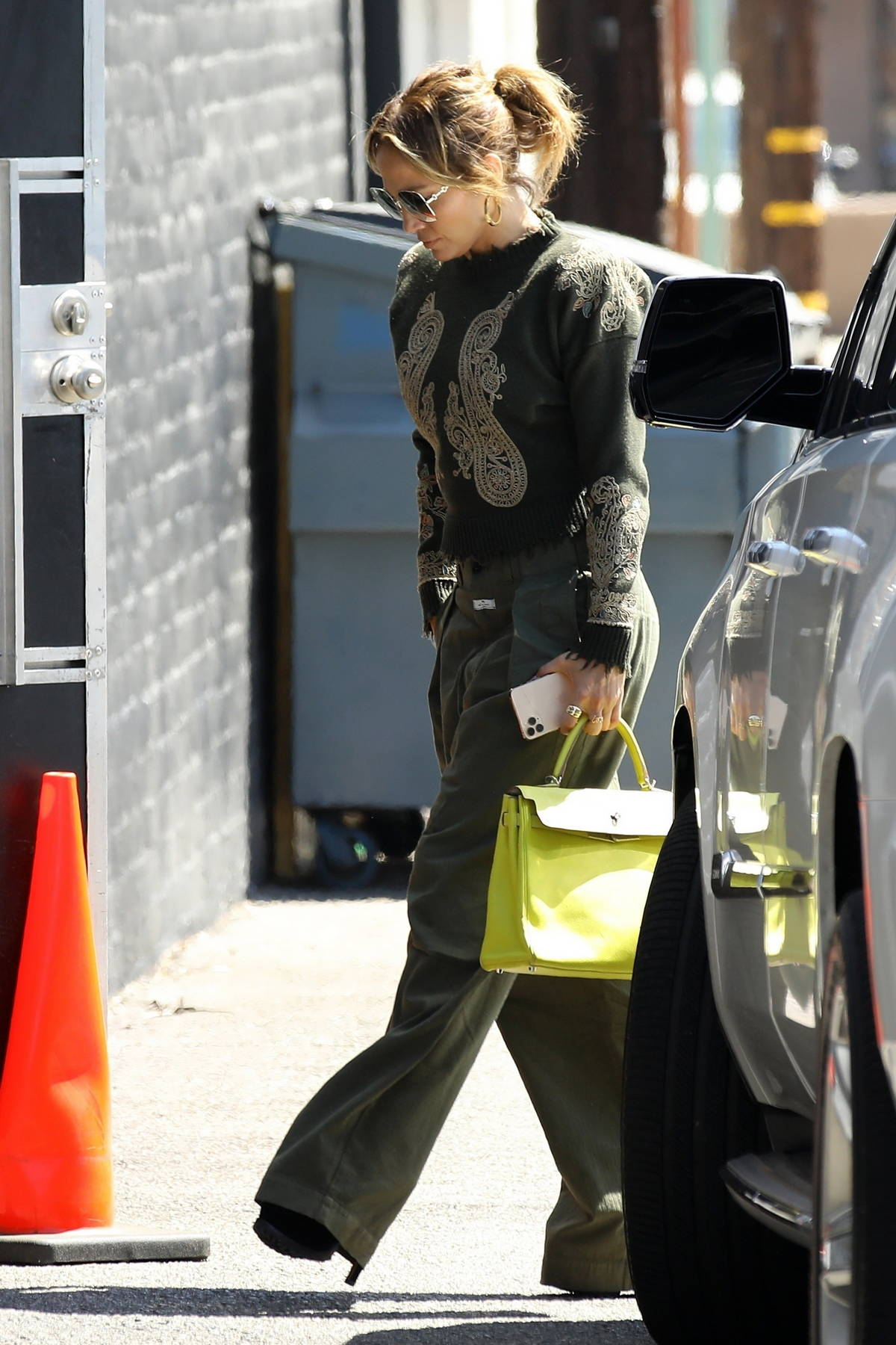 Jennifer Lopez wears a stylish green ensemble while out running errands in Los Angeles