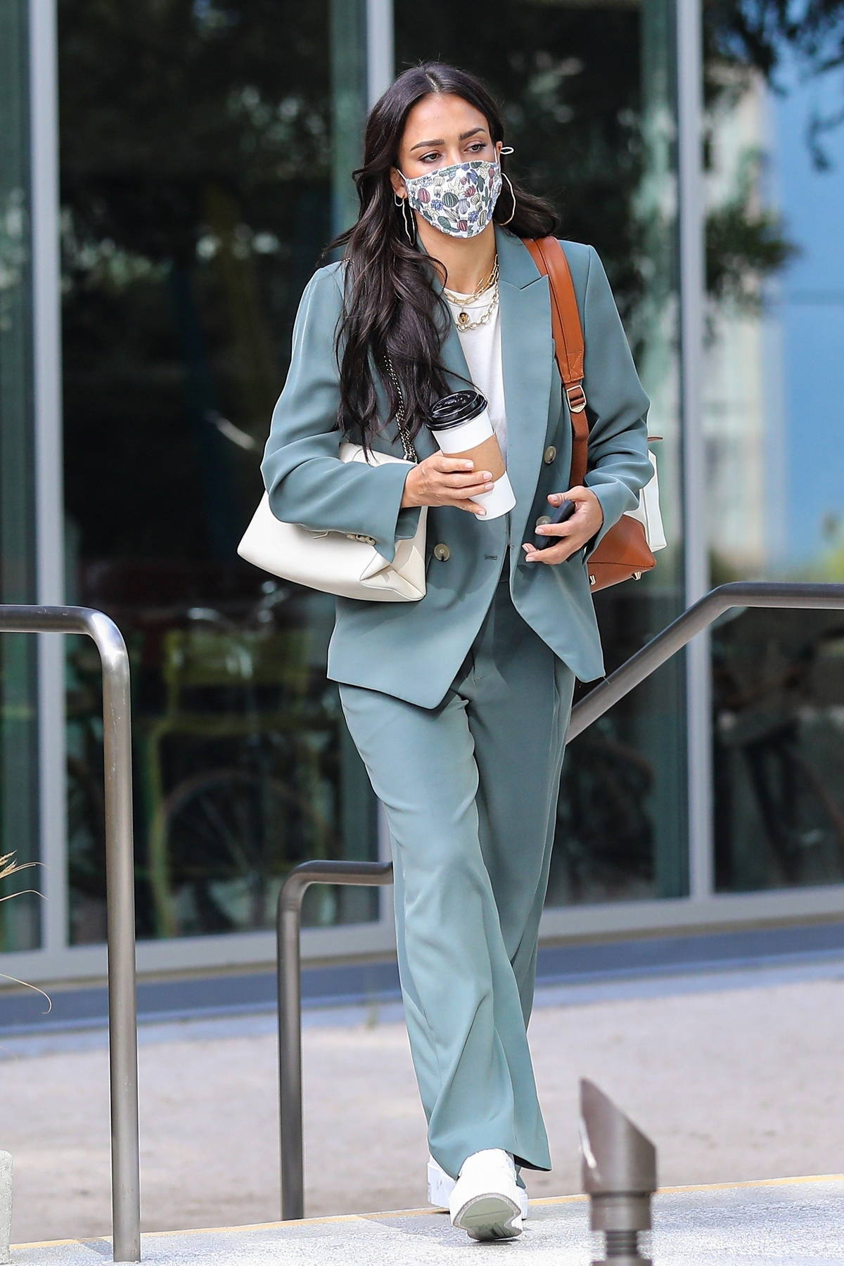 Jessica Alba dons a sage green pantsuit as she arrives at the Honest Headquarters in Playa Vista, California