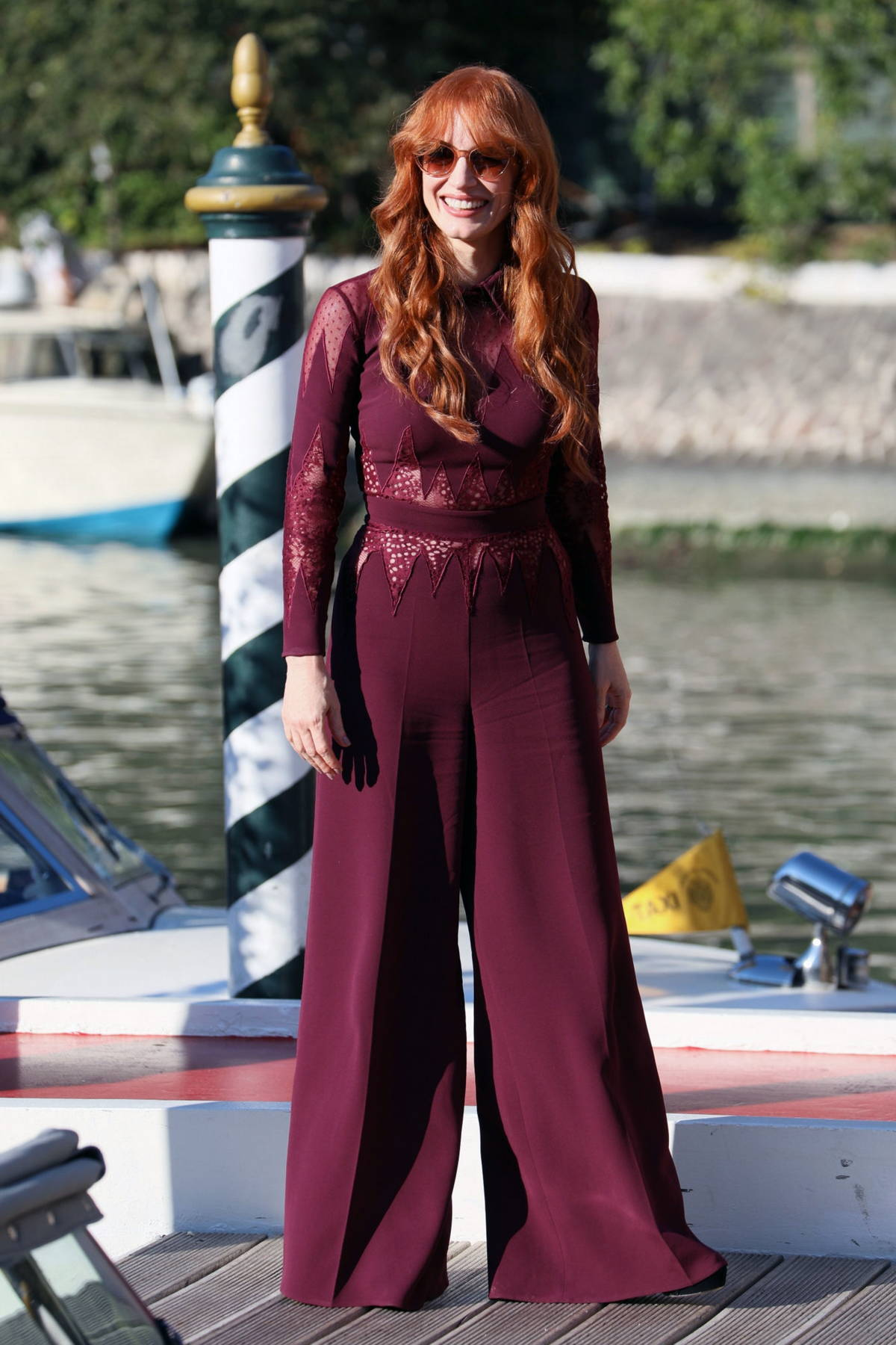 Jessica Chastain looks chic in burgundy as she arrives at the 78th Venice International Film Festival in Venice, Italy