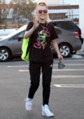 JoJo Siwa waves for the camera and throws a peace sign as she arrives at the DWTS studio in Los Angeles