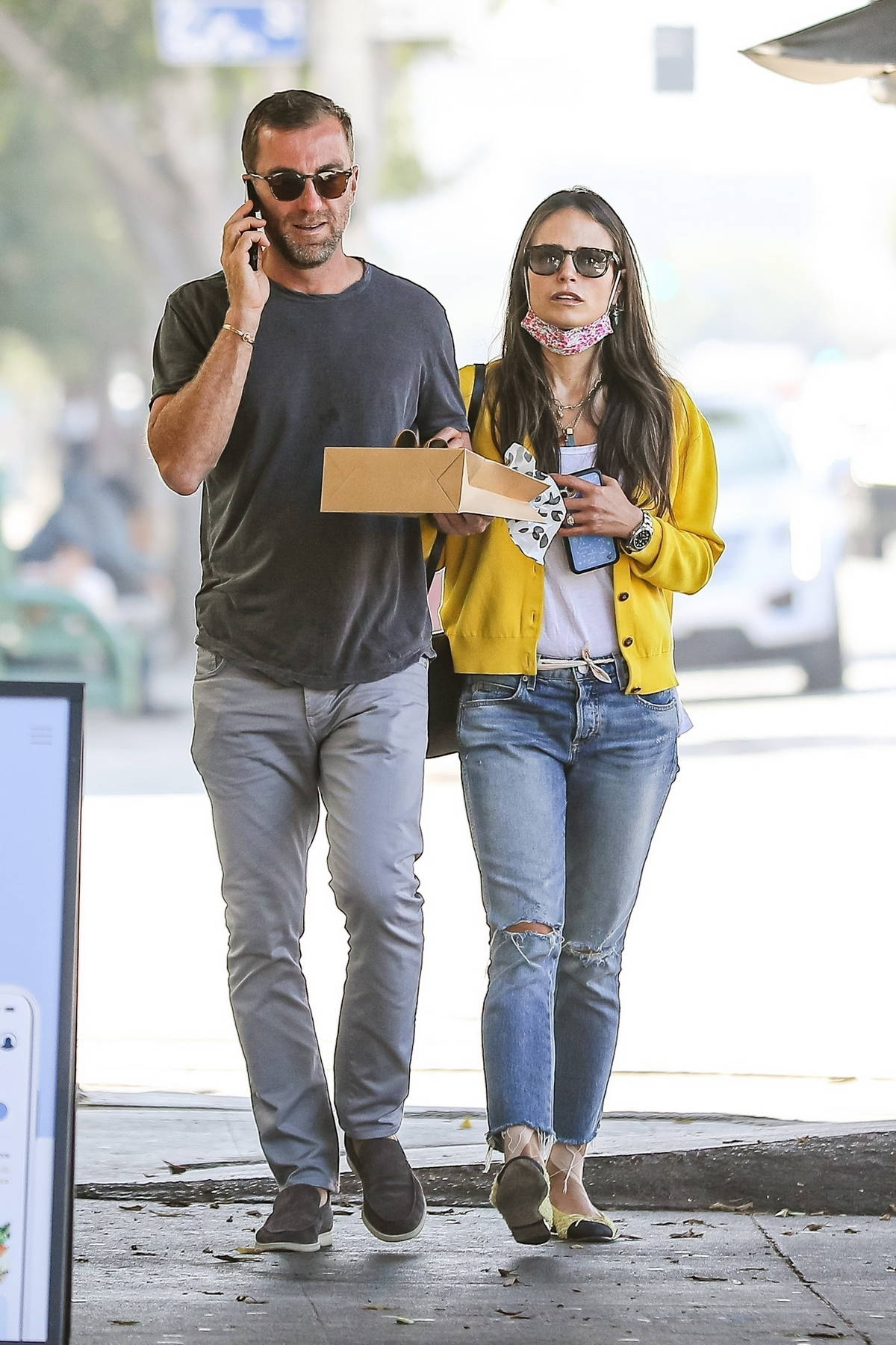 Jordana Brewster shows off her engagement ring during a shopping trip with fiancé Mason Morfit in Hollywood, California