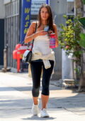 Jordana Brewster wears a white tank top and black leggings while out shopping for sunglasses in West Hollywood, California