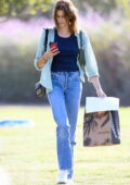 Kaia Gerber keeps things casual in a striped shirt, tank top and jeans during her trip to Erewhon Market in Los Angeles