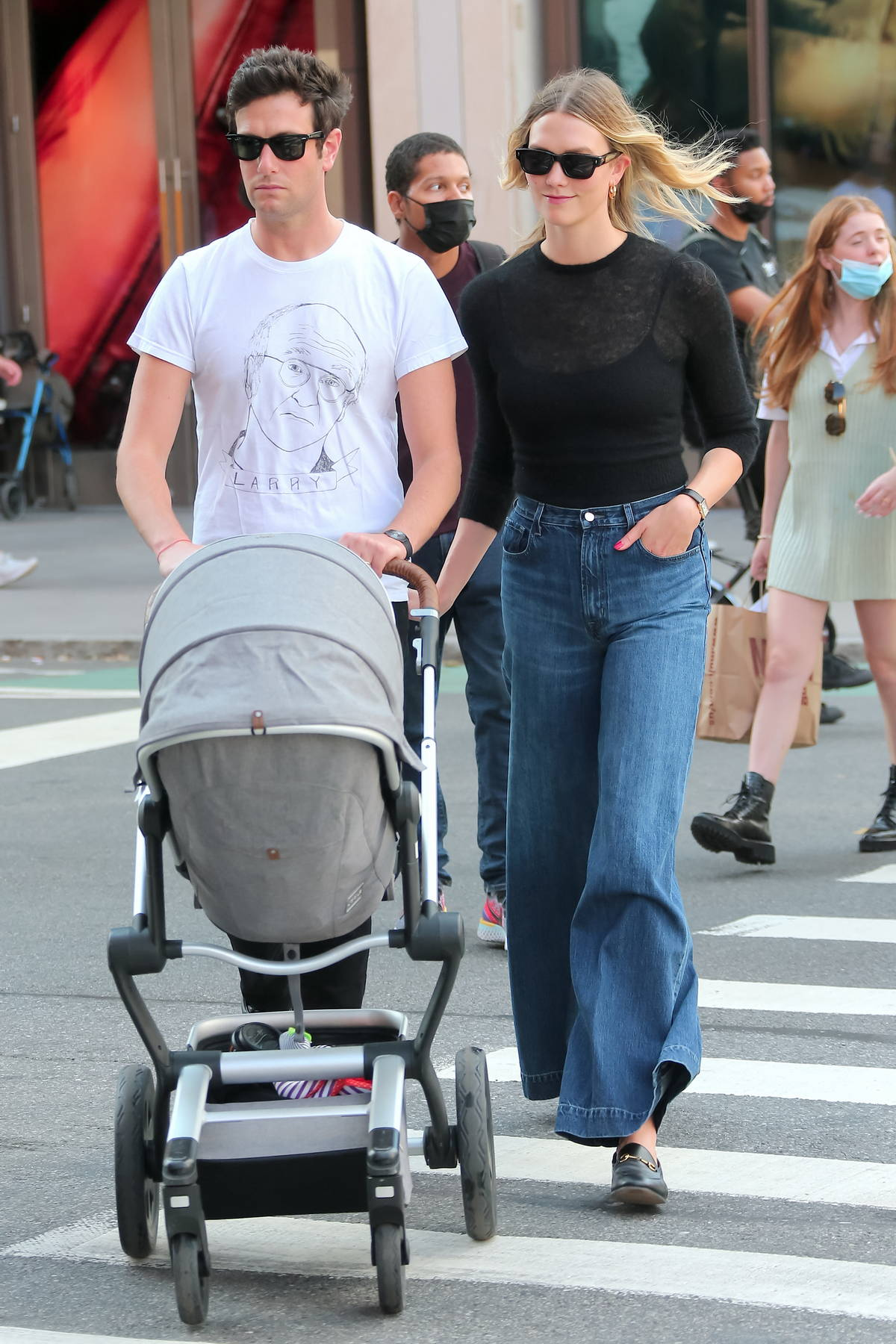 Karlie Kloss steps out for a stroll around Washington Square Park with husband Joshua Kushner and their baby boy in New York City