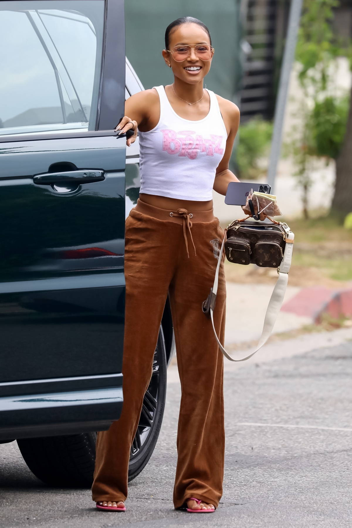 Karrueche Tran is all smiles while stepping out for lunch wearing Bratz sweats in Los Angeles