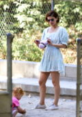 Kate Mara looks cute in a short summer dress as she takes her daughter to the park in Los Feliz, California