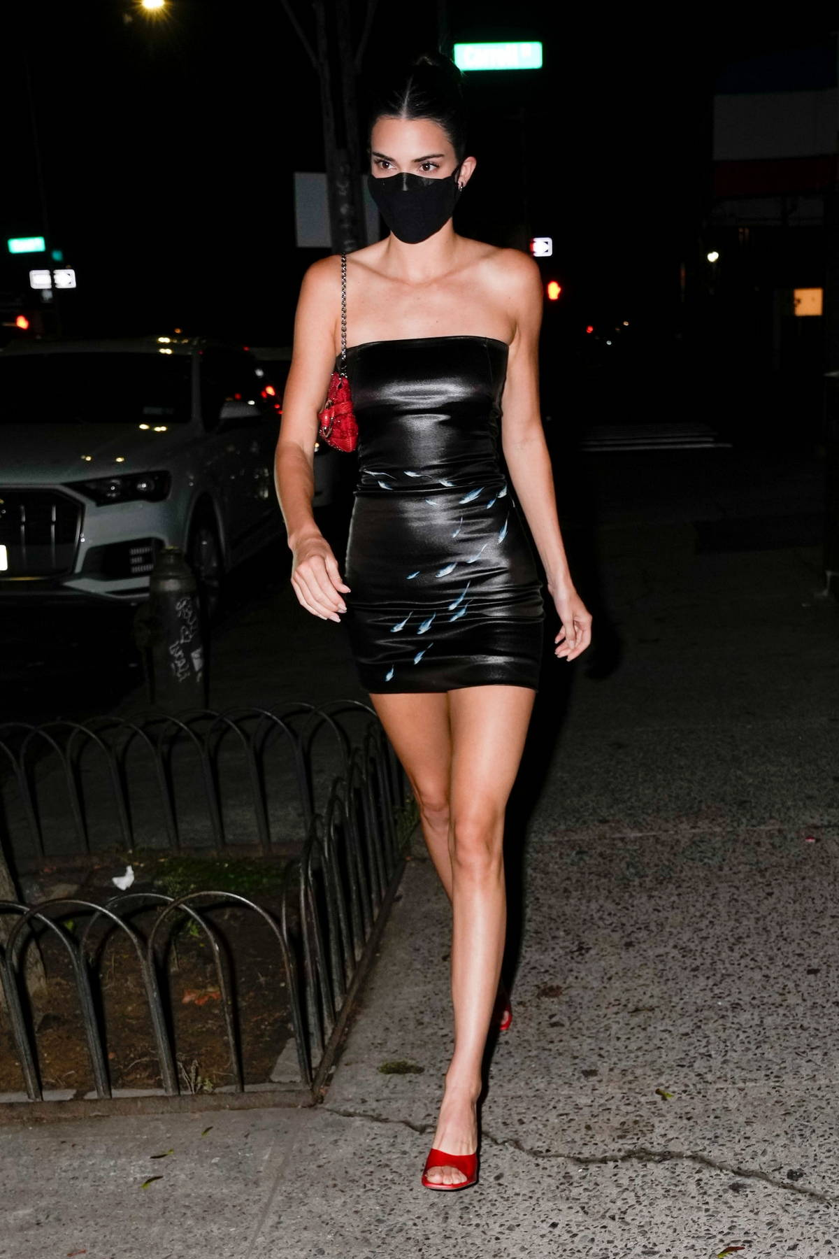 Kendall Jenner displays her slender legs in a black mini dress while attending a birthday party in New York City