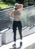 Kendall Jenner rocks a tank top and leggings while visiting a friend in her custom-colored Ferrari in Beverly Hills, California