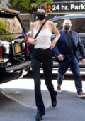Kendall Jenner rocks a white camisole and black trousers as she arrives back to her Hotel in New York City