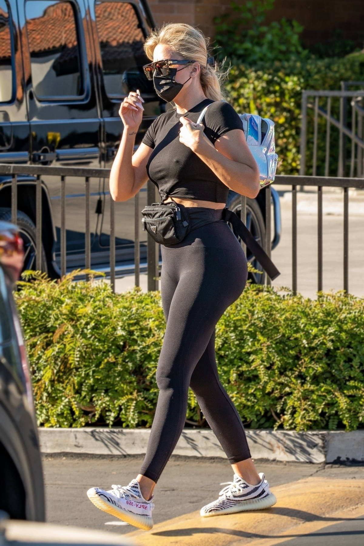 Khloe Kardashian puts her curves on display while taking her daughter to a gymnastics class in Woodland Hills, California