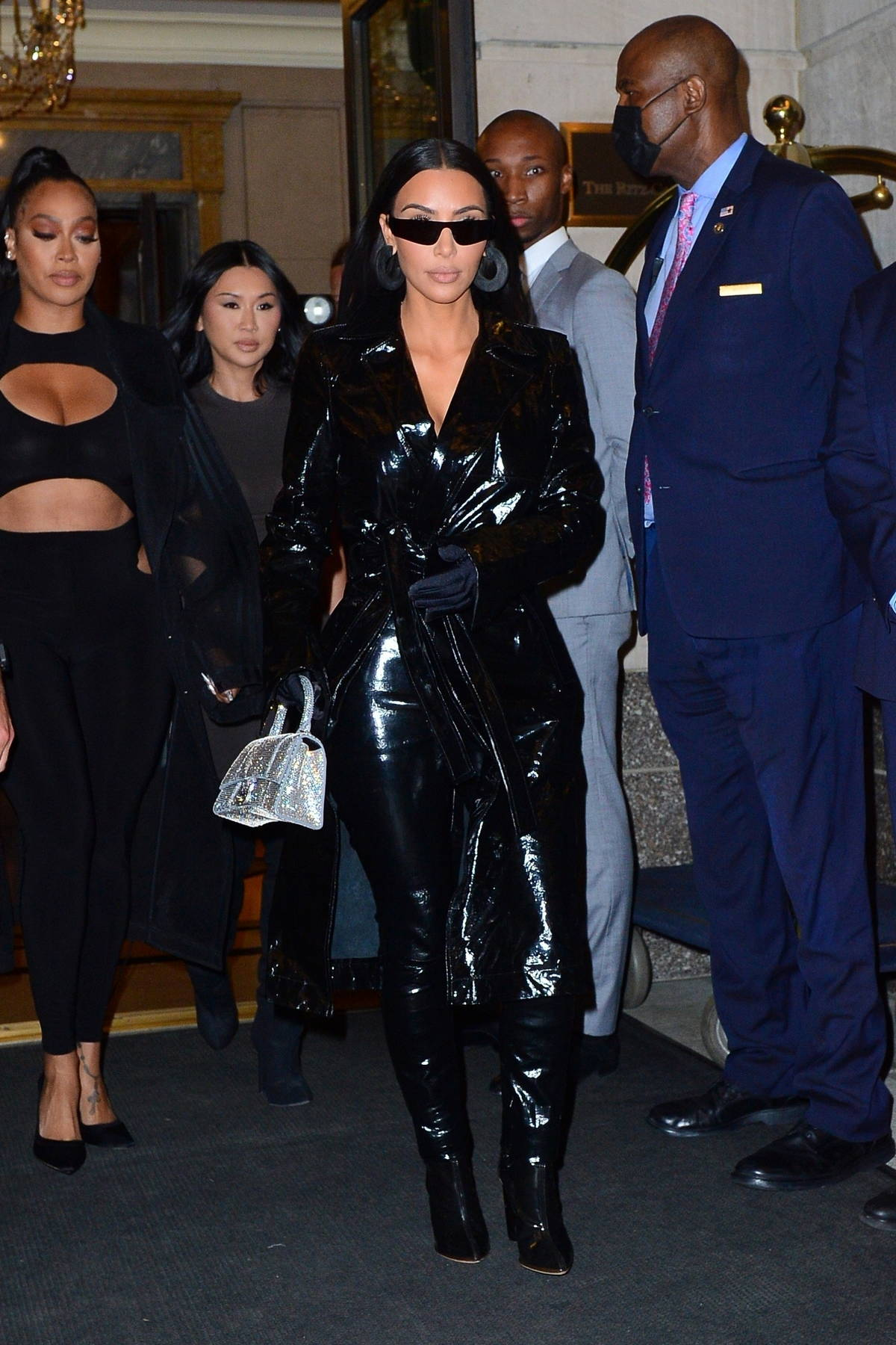 Kim Kardashian rocks an all-black vinyl look while as she leaves her hotel for a night out in New York City
