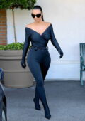 Kim Kardashian wears a plunging skin-tight black Balenciaga outfit for a quick run to CVS in Los Angeles