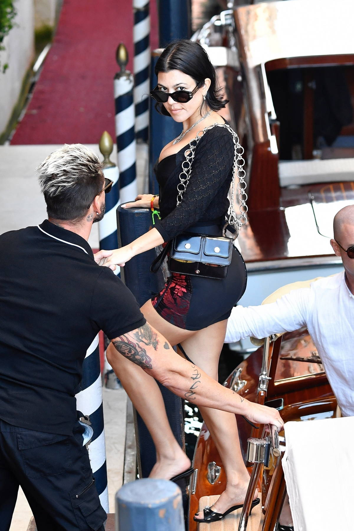 Kourtney Kardashian puts on a leggy display while out enjoying the sights with beau Travis Barker in Venice, Italy