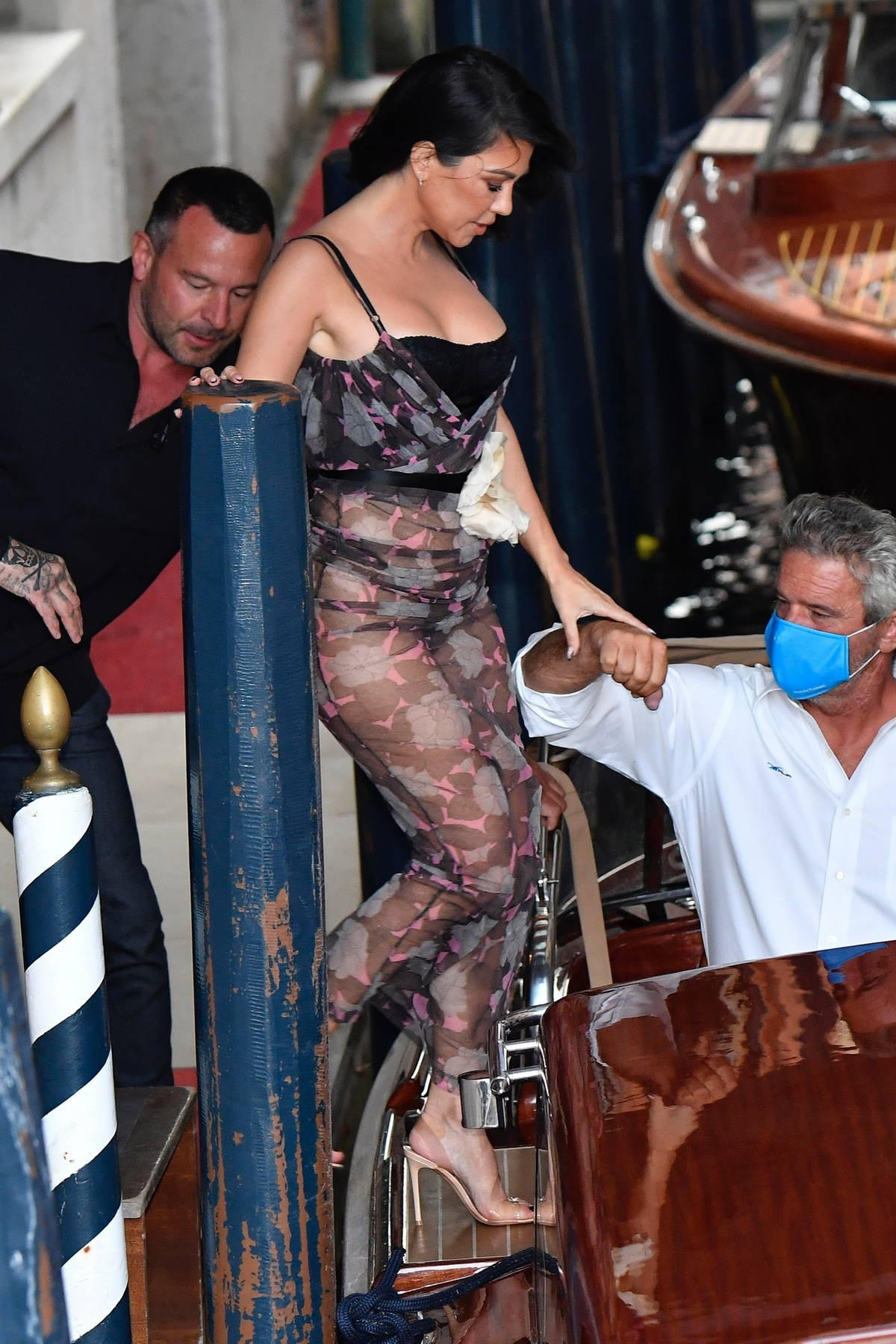 Kourtney Kardashian stuns in a sheer dress while leaving her hotel with Travis Barker in Venice, Italy