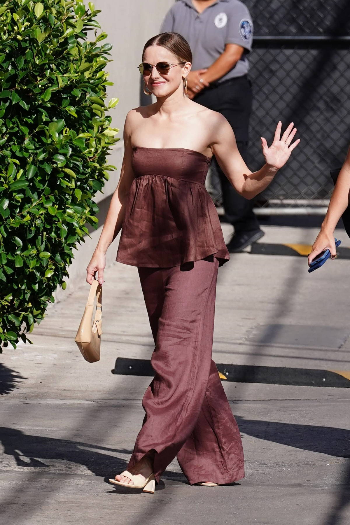 Kristen Bell dons a brown ensemble as she arrives for her appearance on 'Jimmy Kimmel Live' in Hollywood, California