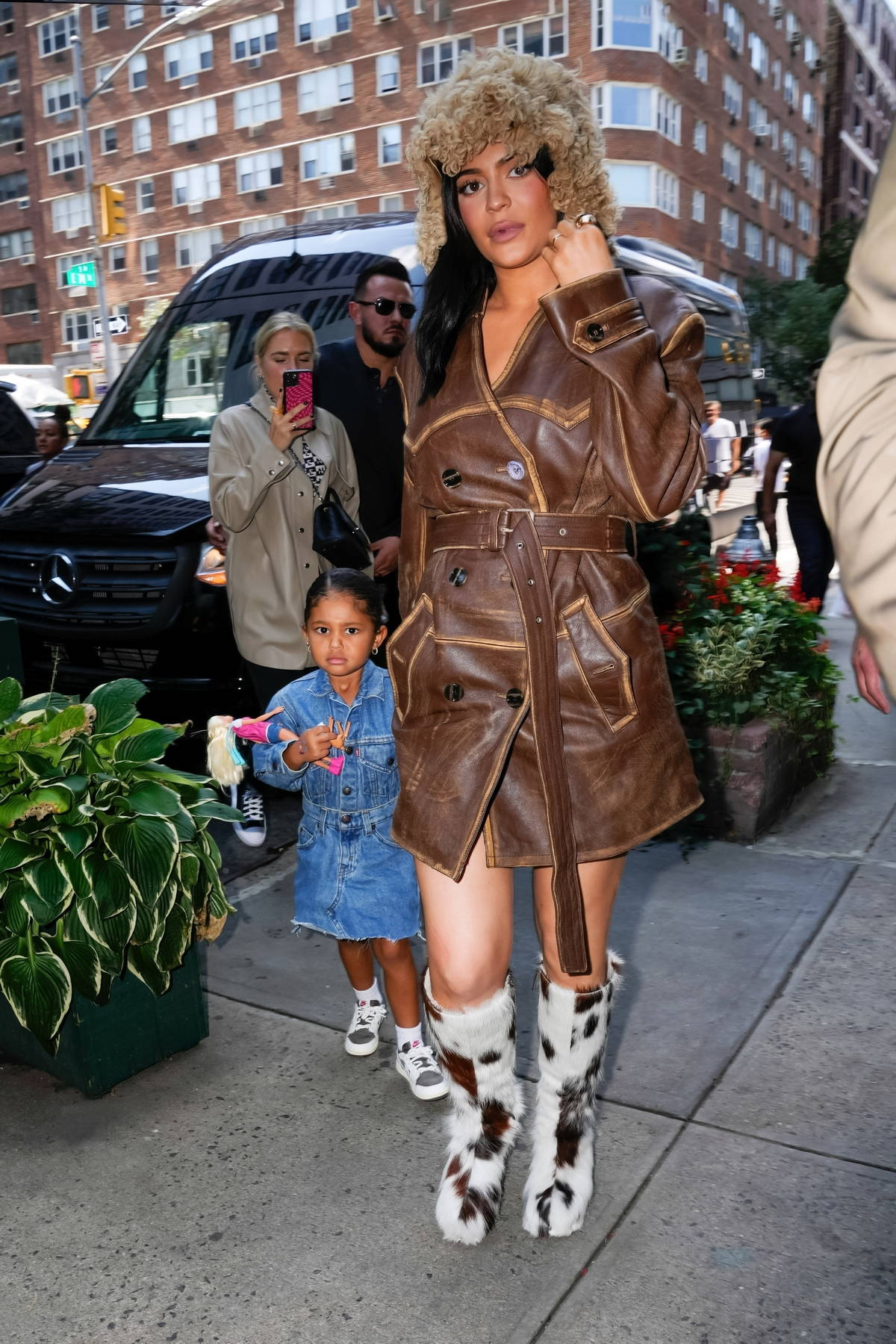 Kylie Jenner keeps it stylish in a leather coat and furry boots while out to grab dinner with her daughter in New York City