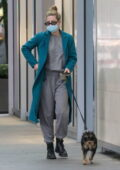 Lili Reinhart keeps cozy in grey sweats and teal overcoat as she takes her dog out for a walk in Vancouver, Canada