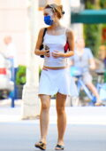 Lily-Rose Depp dons a white crop top and matching short skirt during an afternoon outing in SoHo, New York City