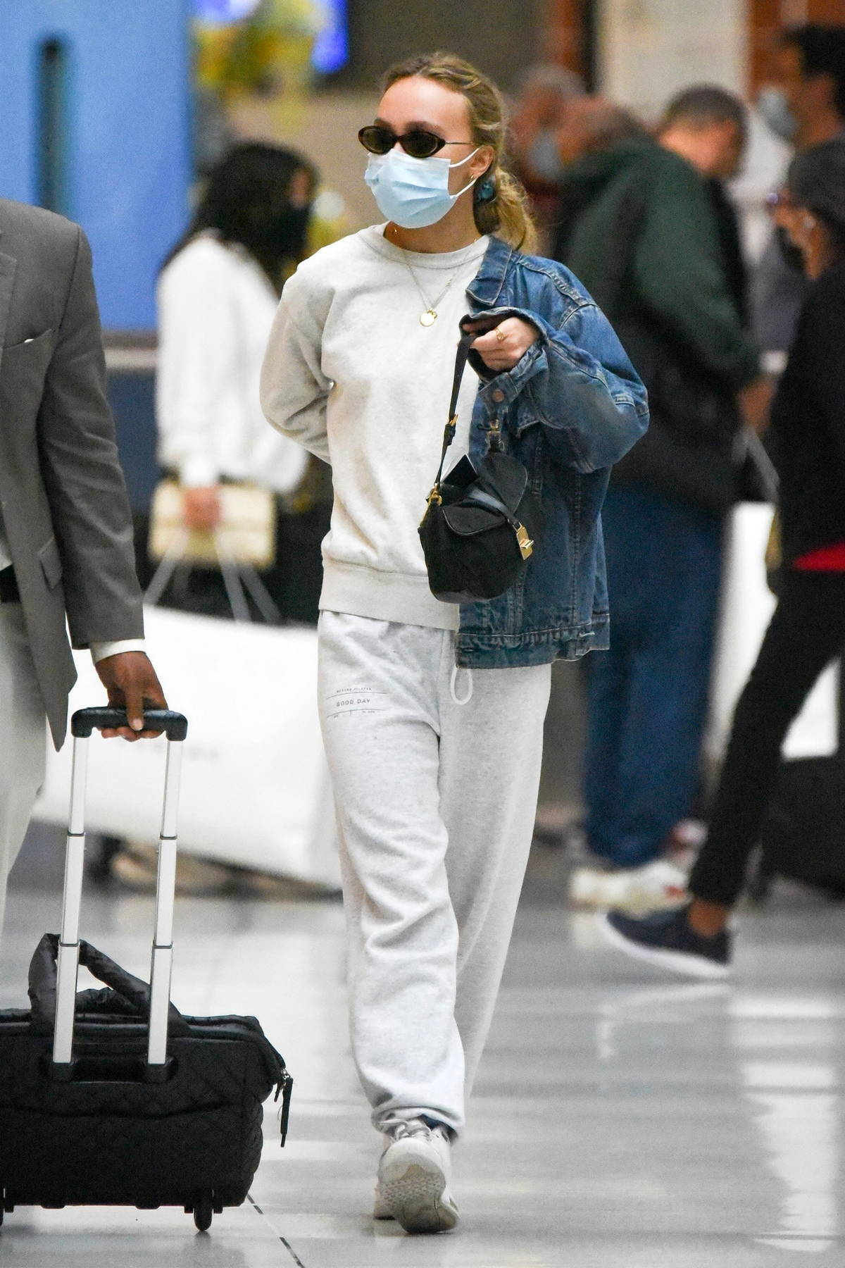 Lily-Rose Depp keeps it cozy in a sweatsuit and denim jacket as she arrives at JFK Airport in New York
