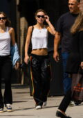 Lily-Rose Depp wears a midriff baring a crop top and Adidas joggers while stepping out in Upper East Side, New York City