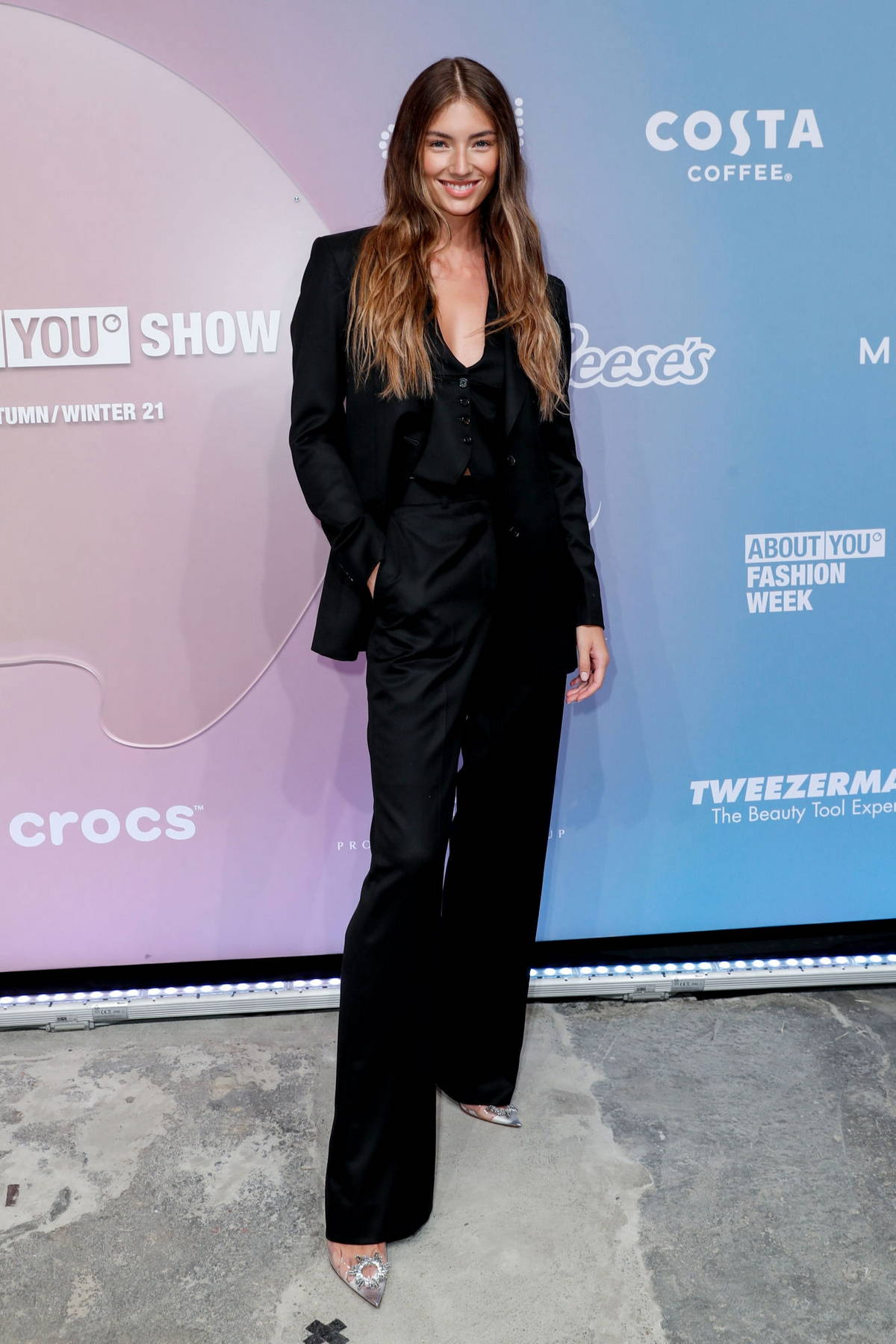 Lorena Rae attends ABOUT YOU opening fashion show at Kraftwerk in Berlin, Germany
