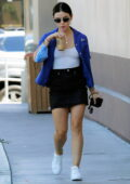 Lucy Hale looks cute in a blue shirt, white top and black mini skirt while out on a shopping trip in Los Angeles