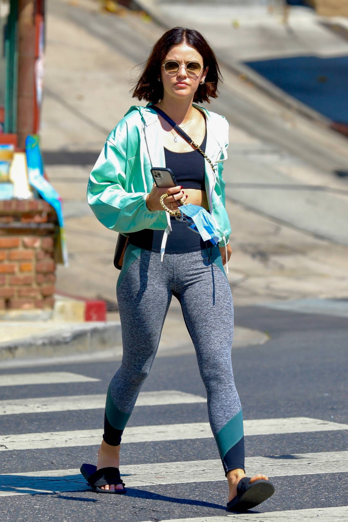 Lucy Hale shows off her taut abs in a sports bra and leggings while leaving Remedy on Sunset after a workout session in Los Angeles