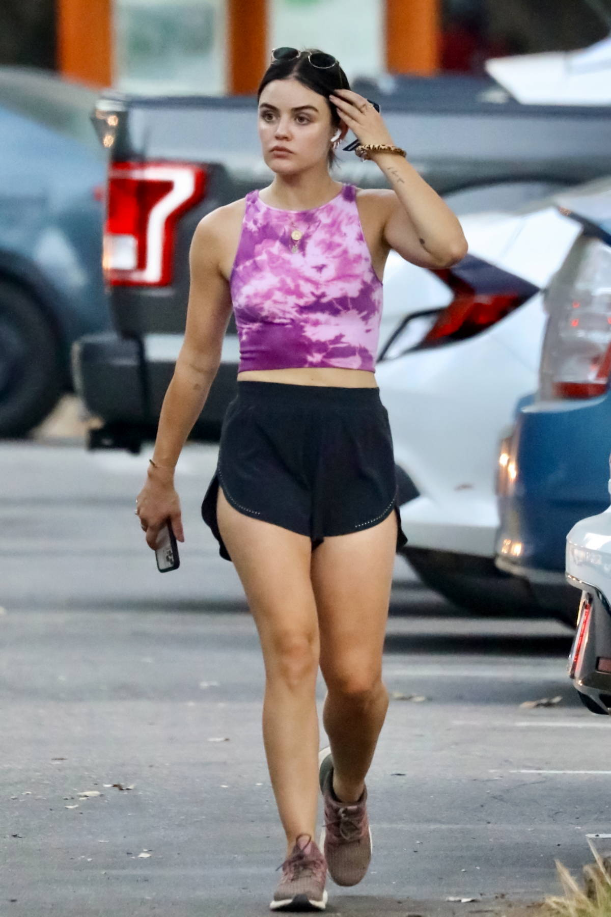 Lucy Hale wears a tie-dye crop top and black shorts while out on a solo hike in Studio City, California