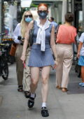 Madelaine Petsch puts on a leggy display in a blue mini skirt with matching top while out in New York City