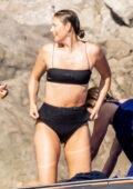 Maria Sharapova looks stunning in a black bikini while enjoying a day on boat in Nerano, Italy
