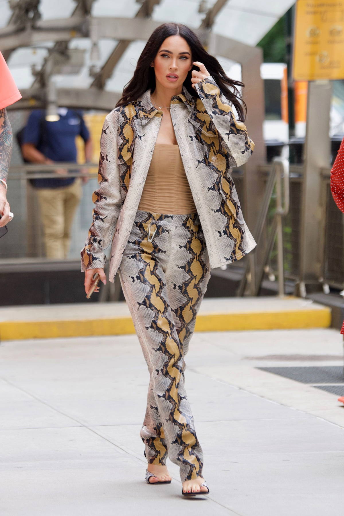 Megan Fox looks fantastic in a snakeskin print jacket with matching pants as she steps out with Machine Gun Kelly in New York City