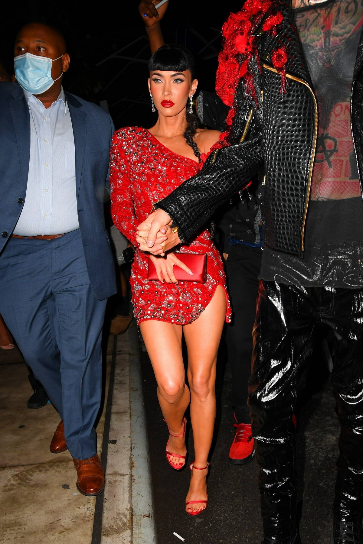 Megan Fox looks gorgeous in a red mini dress while heading to a Met Gala after-party with Machine Gun Kelly in New York City