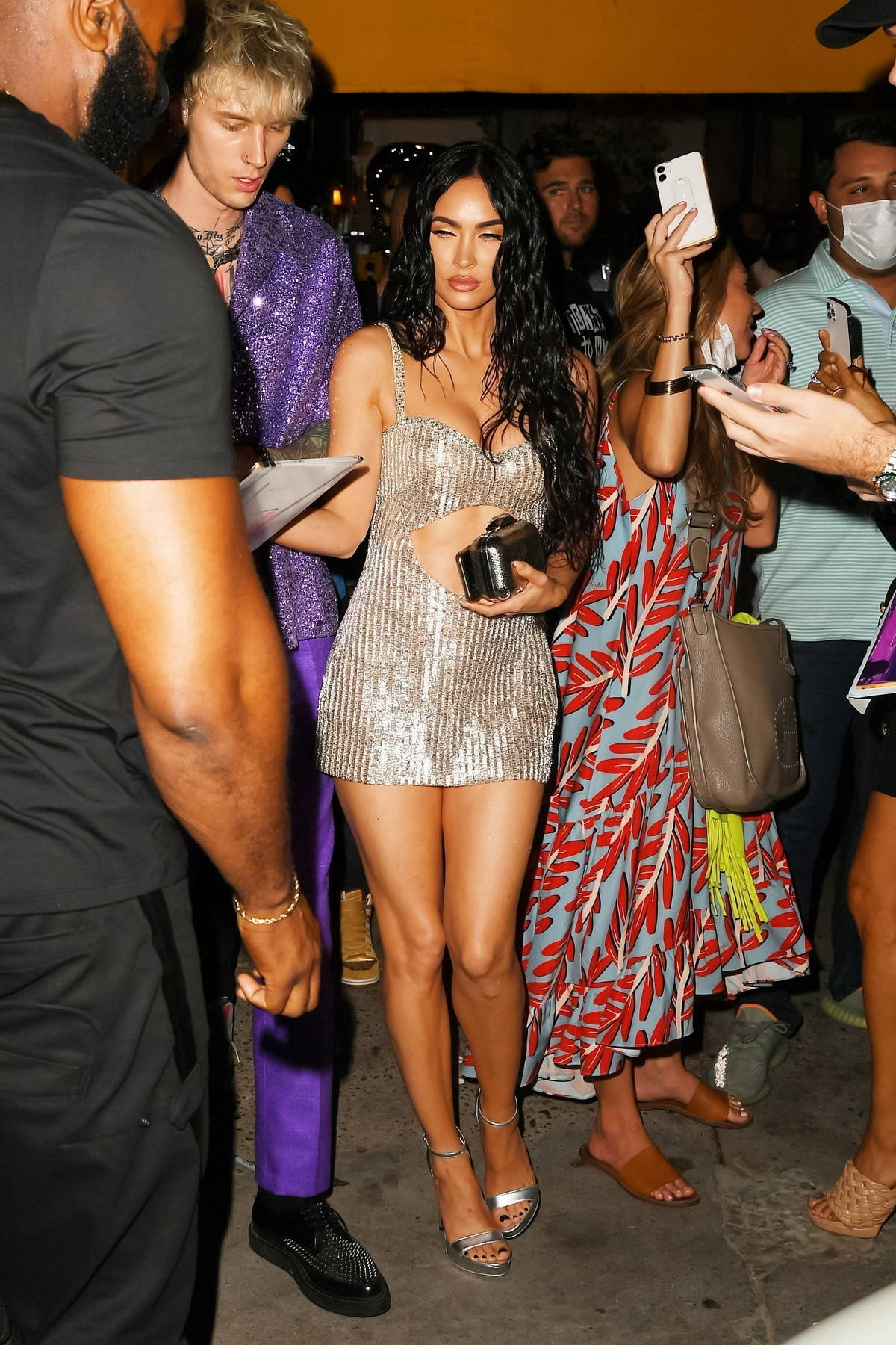 Megan Fox stuns in a metallic silver mini dress while attending a VMA's after-party with Machine Gun Kelly in New York City
