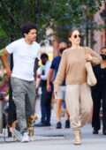 Minka Kelly and boyfriend Trevor Noah step out for a stroll with their pooch in New York City