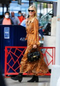 Nicky Hilton looks stylish in an animal print dress while running errands in New York City