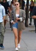 Nina Agdal looks trendy in a blazer, crop top and denim shorts while out with boyfriend Jack Brinkley-Cook in New York