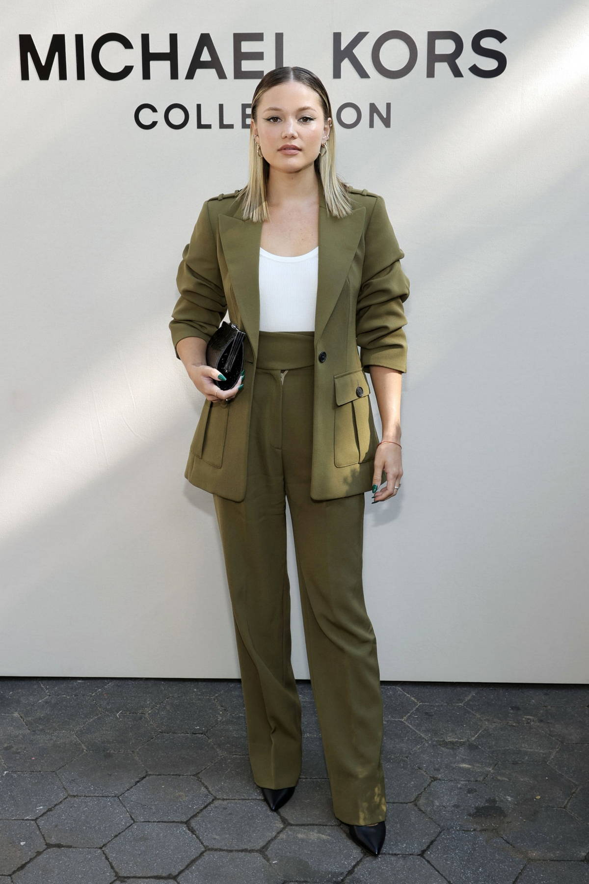 Olivia Holt attends the Michael Kors SP22 fashion show during New York Fashion Week in New York City