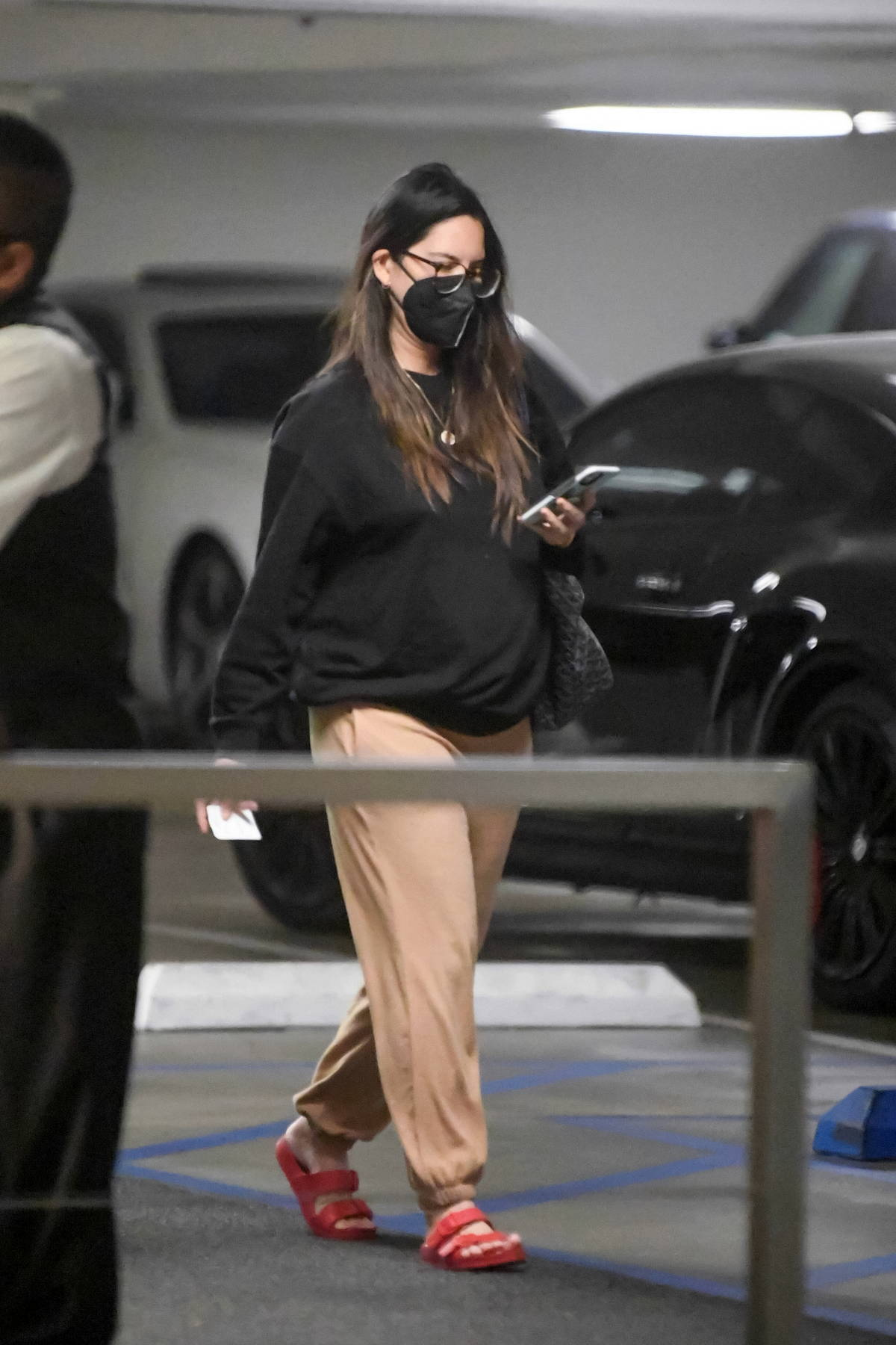 Olivia Munn stays cozy in a baggy sweats while running errands in Beverly Hills, California