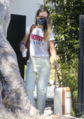 Olivia Wilde packs a suitcase and large leather bag and gets picked up by a limo outside of her home in Los Angeles
