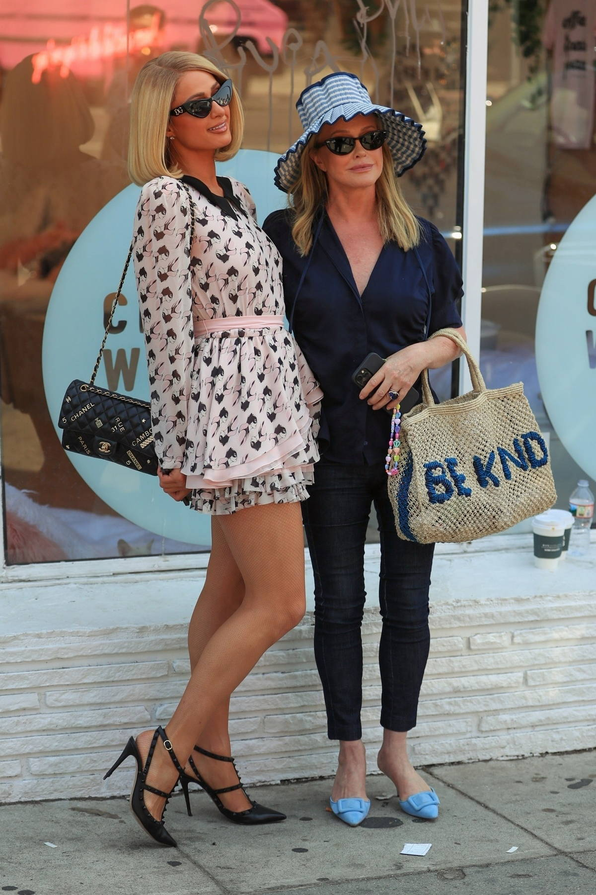 Paris Hilton poses with her mom while filming at Crumbs & Whiskers - Kitten & Cat Cafe on Melrose Ave in Los Angeles