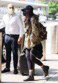 Priyanka Chopra dons animal print 'Christian Dior' hoodie with black leggings as she touches down at JFK Airport in New York City
