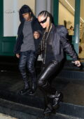 Rihanna rocks a sheer top with bomber jacket and leather pants while out shopping with A$AP Rocky in New York City