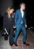 Rita Ora looks amazing in a black suit while enjoying late-night drinks with beau Taika Waititi and friends in Los Feliz, California