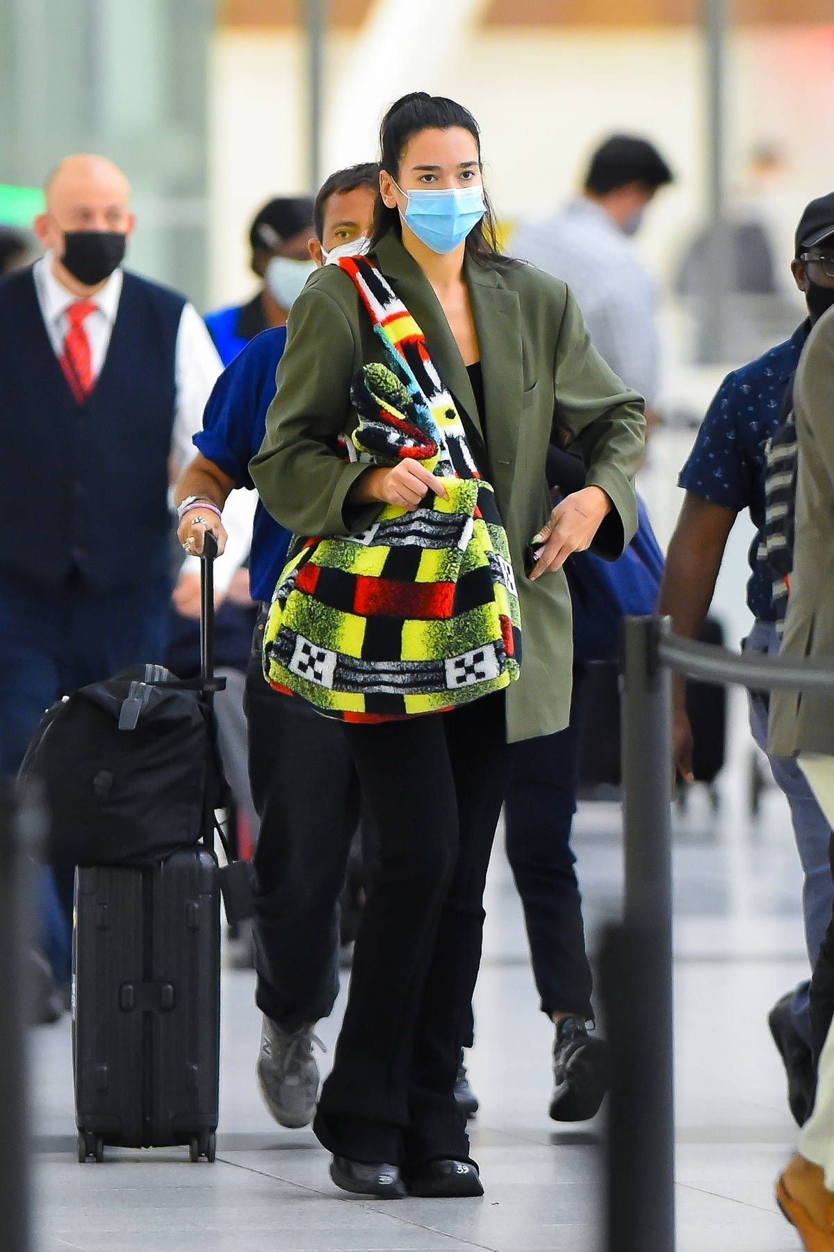 Dua Lipa spotted in a green blazer and colorful tote as she touches down at JFK airport in New York City