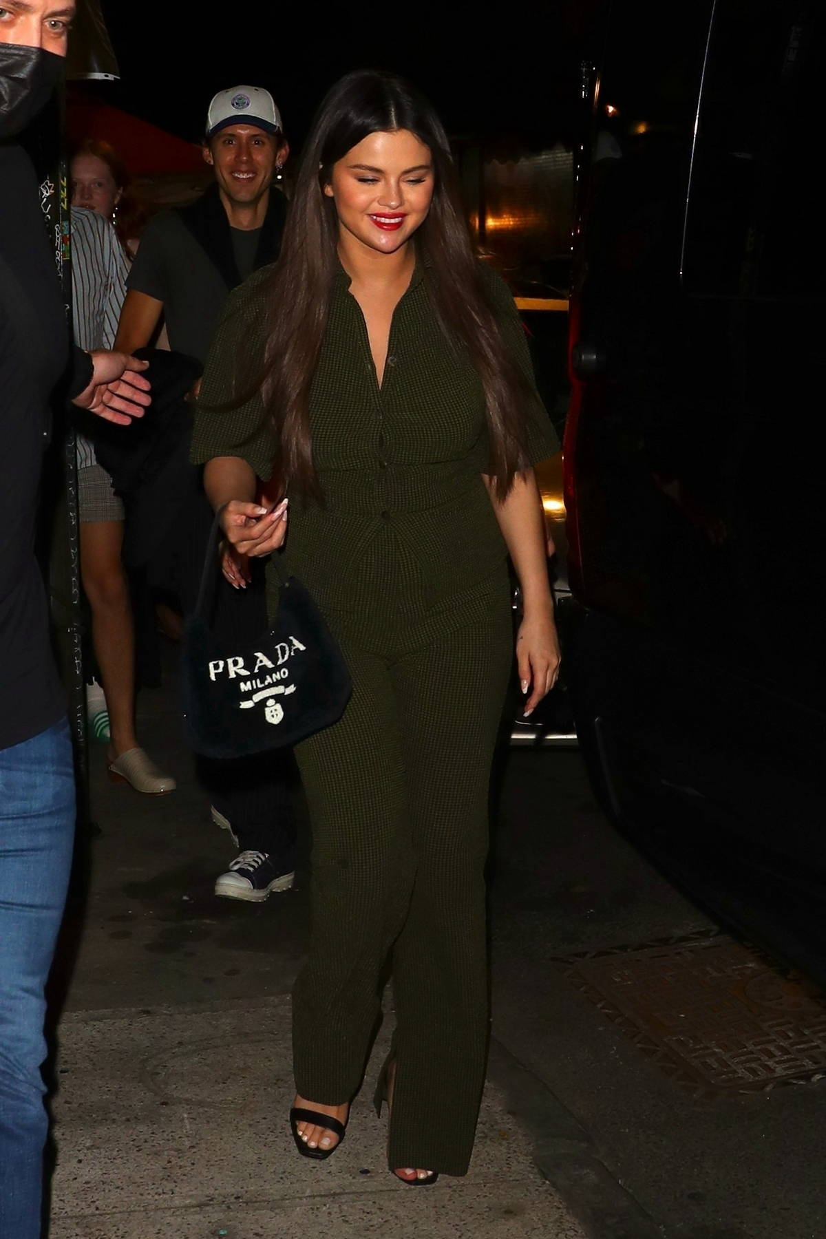 Selena Gomez looks chic in a dark green jumpsuit while out to dinner with friends at Bacaro Italian restaurant in New York City