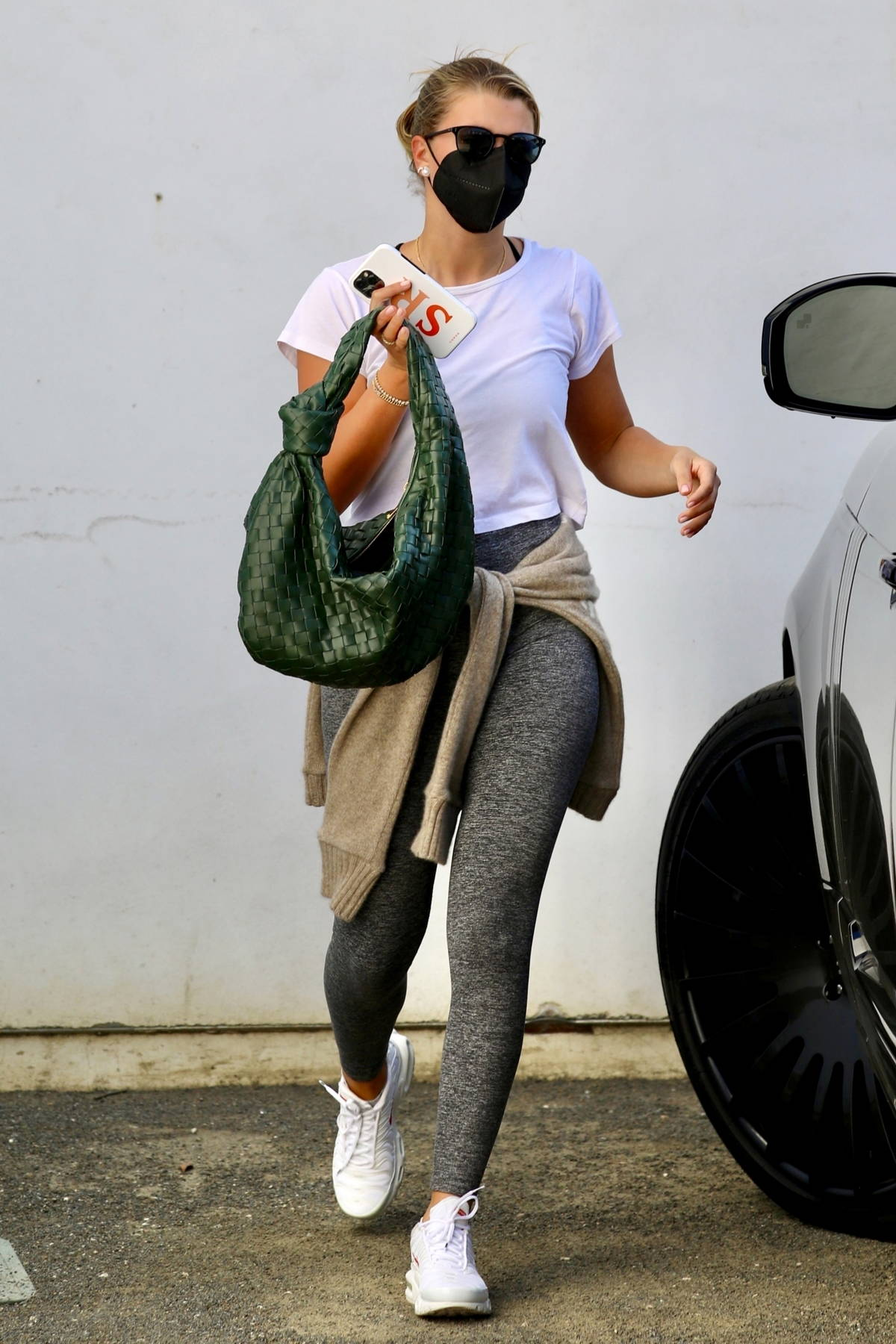 Sofia Richie dons a white tee and grey leggings for a shopping outing at Rick Owens in Los Angeles